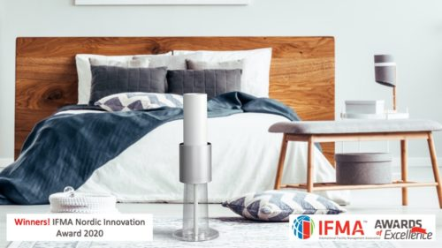 bedroom with bed and white ionflow evolution and banner showing IFMA innovation award winner 2020